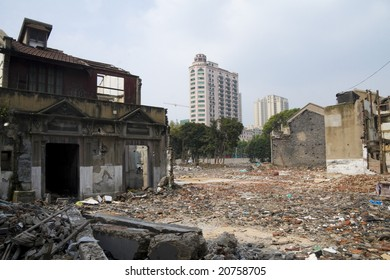 SHANGHAI - AUG 12: Modern skyscrapers rise behind a rubble site, the former houses of expropriated citizens. Picture taken on 12 AUG 2007