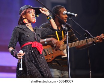 SHANGHAI - AUGUST 4: Jamaican songstress Keisha Patterson with Kurfew band perform on stage at Shanghai World Expo 2010 on August 4, 2010 in Shanghai, China