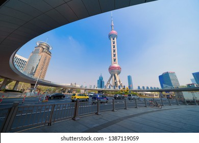 Shanghai, China - 05/03/2019 : Shanghai Oriental pearl TV tower building. Financial district and business centers in smart city in Asia. Skyscraper and high-rise buildings with blue sky