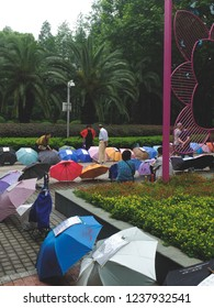 Shanghai, China - 05/25/2018 : Every saturday, some parents come to people square with their umbrella with a description of their childrens  to find them love