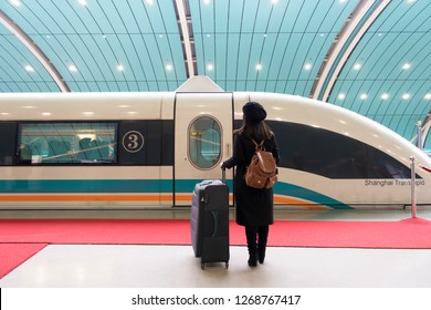 Shanghai, China 08-Dec-2018 A tourist is waitng maglev speed train at the station.