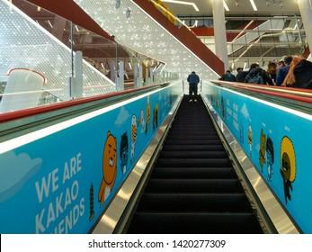SHANGHAI, CHINA - 12 MAR 2019 - Low angle shot of a man on an escalator inside HKR Taikoo Hui shopping mall at Nanjing East Road (Nanjing Dong Lu), Shanghai, China