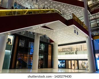 SHANGHAI, CHINA - 12 MAR 2019 - Low angle shot of the 1st floor of HKR Taikoo Hui shopping mall (Also Xing Ye Tai Gu Hui) exterior at Nanjing East Road (Nanjing Dong Lu) pedestrian street