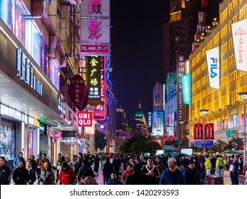 SHANGHAI, CHINA - 12 MAR 2019 - Night /Evening view of the shoppers and neon lights along the crowded pedestrian street at Nanjing East Road (Nanjing Dong Lu), Shanghai, China