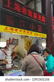 Shanghai, China - 2019-04-14:  Streetfood stand selling skewers of Shanghai Street stinky tofu in Shanghai, China