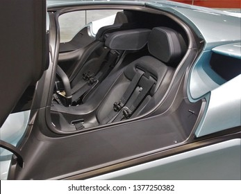 Shanghai/ China - 20th April 2019: Close up of the cabin of a pale blue Nio EP9 electric race car on display at the Shanghai Automobile Industry Exhibition 2019. Fastest electric car on Nurburgring