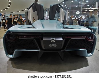 Shanghai/ China - 20th April 2019: Rear view of a pale blue Nio EP9 electric race car with gullwing doors open at the Shanghai Automobile Industry Exhibition 2019. Fastest electric car on Nurburgring