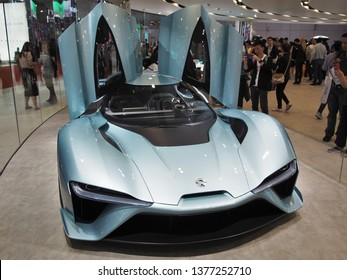 Shanghai/ China - 20th April 2019: Front view of a blue Nio EP9 electric race car with gullwing doors open at the Shanghai Automobile Industry Exhibition 2019. Fastest electric car on Nurburgring