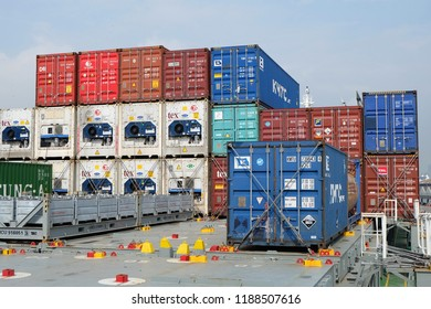 Shanghai, China : 21/09/2017 : Shipping containers are loaded on deck onboard of cargo ship in Shanghai, China.