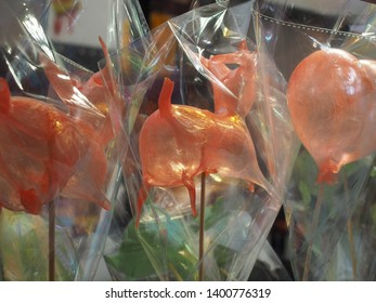 Shanghai/ China - 25th April 2019: Blown sugar lollipops in the shape of pigs wrapped in cellophane, for sale in a market in Yu Yuan Gardens, to celebrate the Chinese Year of the Pig