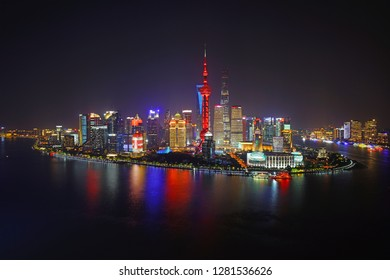 SHANGHAI, CHINA -26 OCTOBER 2018- A night view of the modern Pudong skyline across the Bund in Shanghai, China. Shanghai is the largest Chinese city.