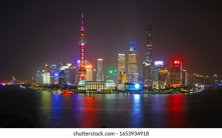 SHANGHAI, CHINA -27 OCT 2019- A landscape view at night of the modern Pudong skyline cityscape across the Bund in Shanghai, China. Shanghai is the largest Chinese city.