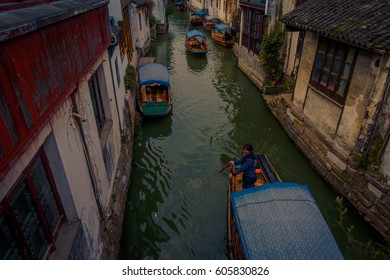 SHANGHAI, CHINA - 29 JANUARY, 2017: Famous Zhouzhuang water town, ancient city district with channels and old buildings, charming popular tourist area
