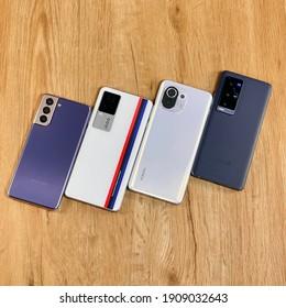 Shanghai, China - 3 February 2021: Samsung Galaxy S21 Plus, iQOO 7, Xiaomi Mi 11 and Vivo X60 Pro+