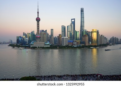 SHANGHAI, CHINA -30 OCTOBER 2018- Day view of the modern Pudong skyline seen from the landmark classic Peace Hotel on the Bund in Shanghai, China. Shanghai is the largest Chinese city.