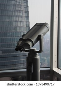 Shanghai/ China - 7th April 2019: Telescope on the viewing deck on Jin Mao Tower with the Shanghai Tower in the background in the financial district of Shanghai (Lujiazui)