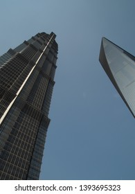 Shanghai/ China - 7th April 2019: Looking up at the Jin Mao tower and the World Financial Centre tower (the bottle opener) in Lujiazui , the financial district in Shanghai