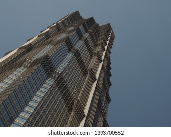 Shanghai/ China - 7th April 2019: Looking up at the modern art deco style Jin Mao Tower (which contains the Grand Hyatt hotel) in Lujiazui , the financial district in Shanghai