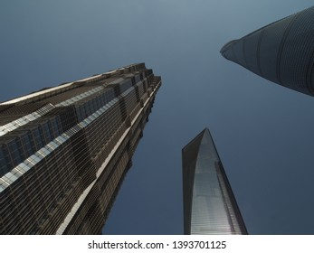 Shanghai/ China - 7th April 2019: Looking up at tall towers of Lujiazui , the financial district in Shanghai showing the Shanghai Tower, World Financial Centre and Jin Mao Tower