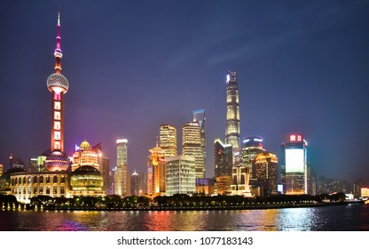 Shanghai, China - Apr. 24, 2018: Night time view of high rises in the new Pudong district of Shanghai, China.