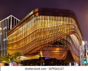 Shanghai, China - Apr. 24, 2018: Fosun Foundation cultural and arts center with moving curtain-like façade made of bronze tubes.