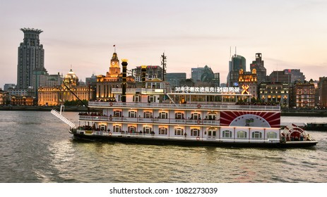 Shanghai, China - Apr. 24, 2018: Cruise boat on Huangpu River, taking tourists to view landmark high rises in new Pudong district, Shanghai, China.