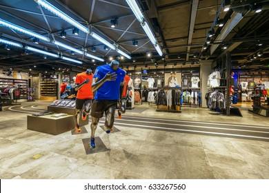 SHANGHAI, CHINA - APR.21. 2017. Multi sports brands in shopping mall interior. Multi luxury brand inside.