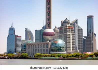 SHANGHAI, CHINA - APRIL, 13, 2019: Cityscape and detail of bottom part of skyscrapers in Shanghai viewed from historical Bund district.