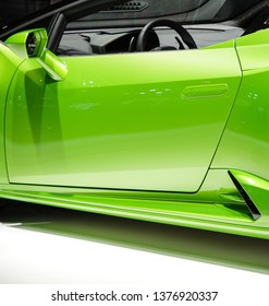 Shanghai, China - April 16th 2019: 18th Shanghai International Automobile Industry Exhibition green Lamborghini Huracan EVO Spyder convertible super car body side detail