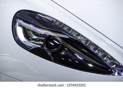 Shanghai, China - April 16th 2019: White Aston Martin Vanquish sports car headlight detail at 18th Shanghai International Automobile Industry Exhibition