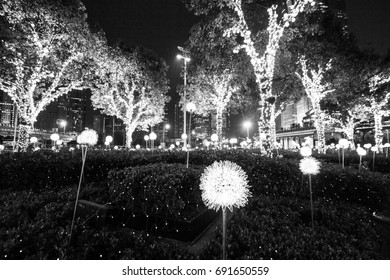Shanghai, China - April 2016: Shanghai city illumination by night, trees decorated with lights, Shanghai center, China