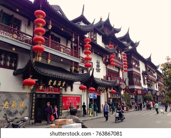 Shanghai, China - April 2016: Shanghai old town street decorated with red chinese lanterns. Street market in Shanghai, Chinese lanterns on the houses, China