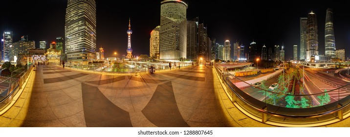 SHANGHAI, CHINA - APRIL 21, 2015: 360 degrees skyline of Pudong financial center by night with Jin Mao, SWFC, Oriental Pearl & Shanghai highest tower. Pedestrian, aerial walkway at Lujiazui in front.