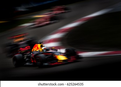 Shanghai, China - April 9, 2017: Low key blurred photo style of Red Bull racing Team car on Formula One Chinese Grand Prix at Shanghai Circuit.