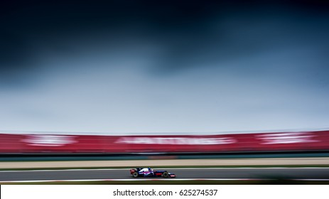 Shanghai, China - April 9, 2017: motion blurred style photo of dynamic power of F1 car Daniil Kvjat driver Toro Rosso team at Formula One Chinese Grand Prix at Shanghai Circuit.