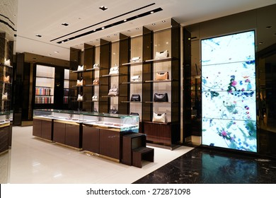 SHANGHAI, CHINA - APRIL.25, 2015: Gucci store at night. Gucci is an Italian fashion and leather goods brand was founded by Guccio Gucci in Florence in 1921. Gucci has about 425 stores worldwide.