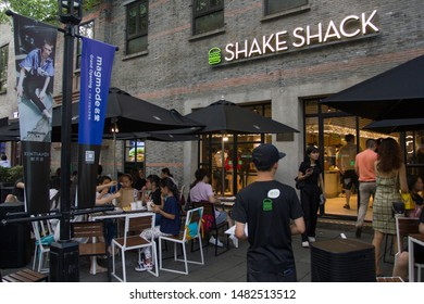 Shanghai, China - Aug 19, 2019: The Shake Shack restaurant with outdoor seating at Xintiandi. Shake Shack is an American fast casual restaurant chain, which started out as a hot dog cart in 2001.