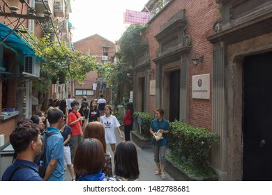 Shanghai, China - Aug 19, 2019: Korean visitors in the narrow alleyway outside the former provisional government site of the Republic of Korea at Shanghai's Xintiandi.