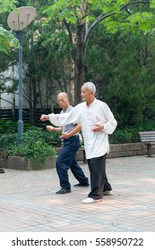 SHANGHAI, CHINA - AUG 20, 2016 The lesson of Wushu in a city Park.
