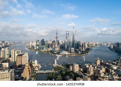 Shanghai, China - Aug 22, 2019: aerial view of Lujiazui, Shanghai city, landmarks of Shanghai with Huangpu river in the afternoon
