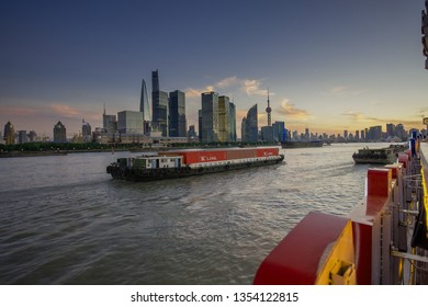 SHANGHAI, CHINA - AUGUST 29, 2016: Twilight view of Shanghai skyline and the Huangpu river against Pudong District, Shanghai, China on August 29, 2016.
