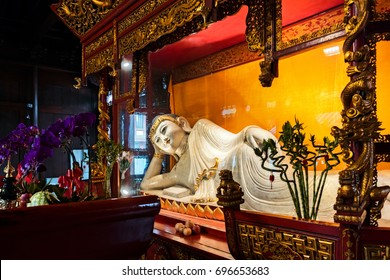 SHANGHAI CHINA - August 5, 2017: Recycling Buddha statue in Jade Buddha Temple. In 1882 an old temple was built to keep two jade Buddha statues which had been brought from Burma by a monk named Huigen