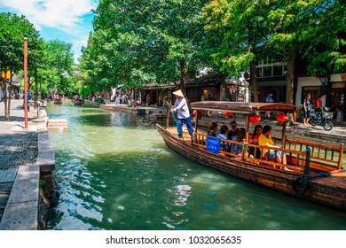Shanghai, China - August 8, 2016 : Chinese traditional wooden boats on canal of Shanghai Zhujiajiao water town