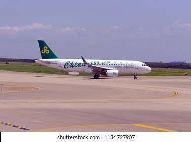 SHANGHAI CHINA CIRCA JUNE 2018. Spring Airlines, Chinese low cost airline airliner illustrates the global trend of lower budget airlines aiming to take market share away from larger peers