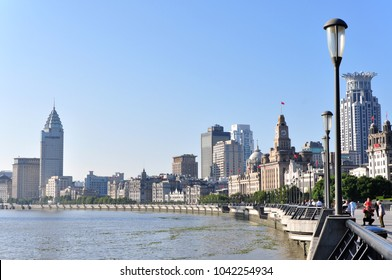 SHANGHAI, CHINA- CIRCA OCT 2017: Unidentified people in a The Bund in Shanghai China. The Bund or Waitan is a waterfront area in central Shanghai