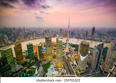 Shanghai, China cityscape overlooking the Financial District and Huangpu River.