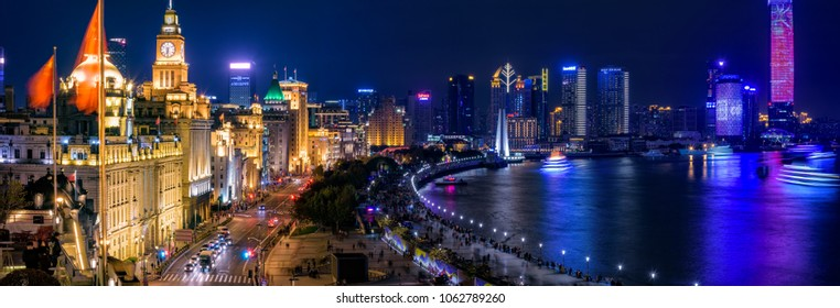 "Shanghai, China - December, 2017 :Nightscape of Shanghai ""The Bund"". The Bund in Shanghai  is a waterfront area in central Shanghai."