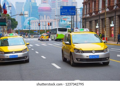 SHANGHAI, CHINA - DECEMBER 25, 2017: Yellow taxi cabs on the city street of Shanghai, China