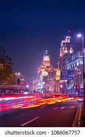 SHANGHAI, CHINA - December 31 2017: Historical architecture on the bund of Shanghai with City lights and traffic lights at night is a popular tourist destination of Asia. Shanghai, China