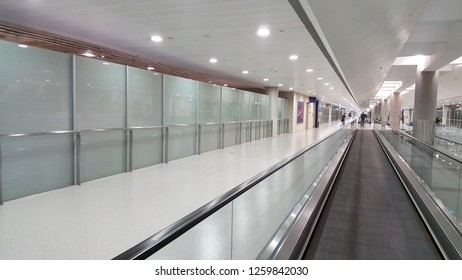 Shanghai / China - December 5 2018: Moving walkway in Pudong Airport arrival hall